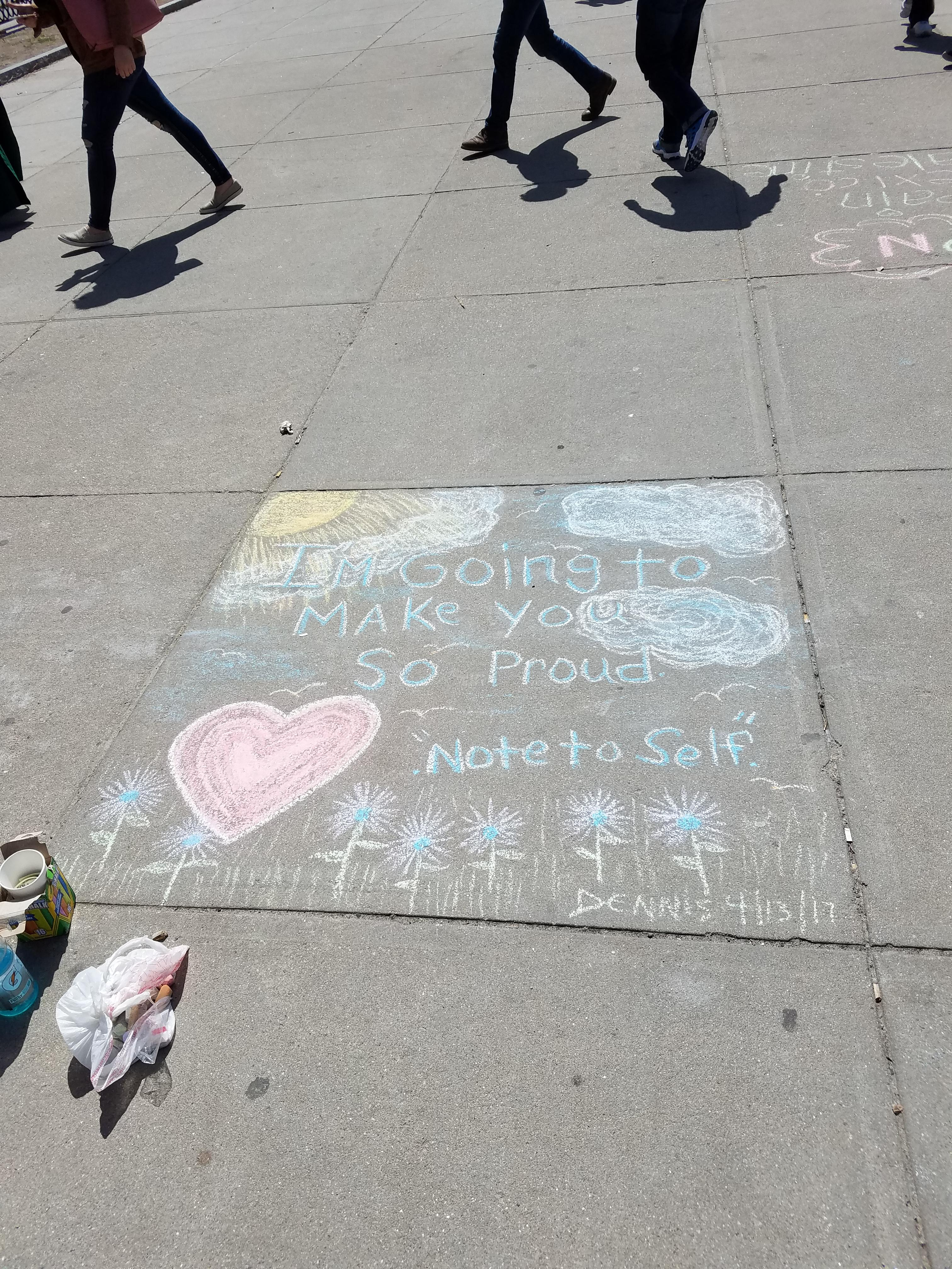 [Image] downtown Dennis, of Boston mA, draws messages of hope with chalk (OC)