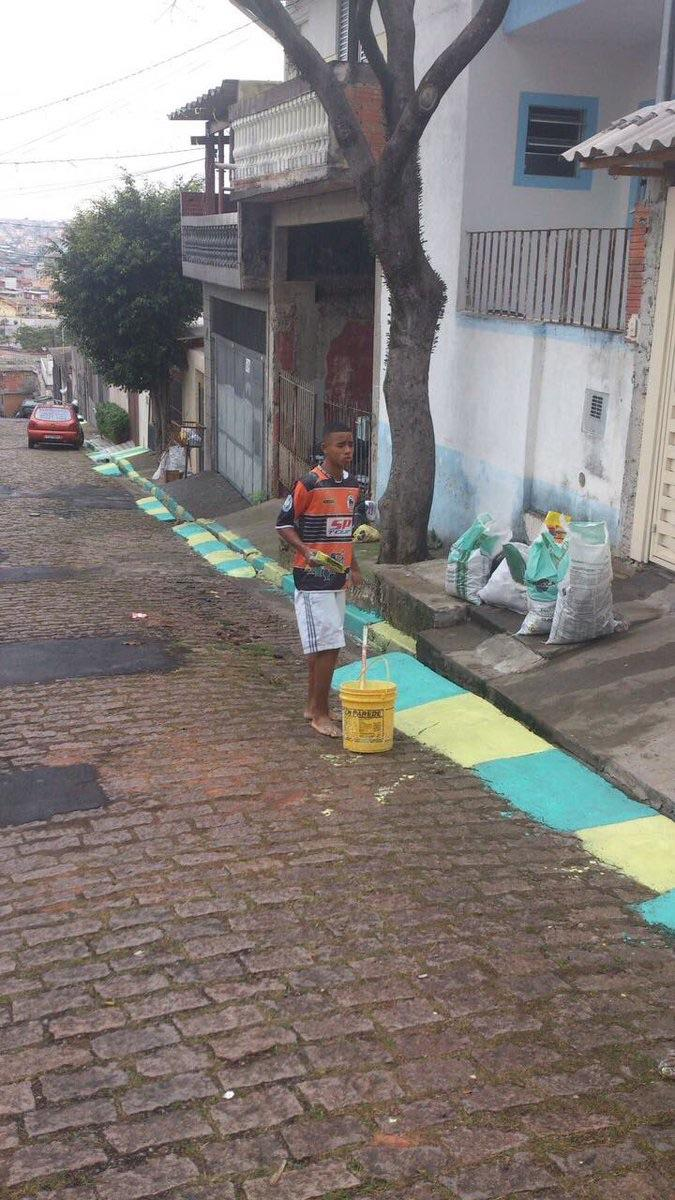 [Image] Football star Gabriel Jesus painting his street before the 2014 World Cup in Brazil. He has gone on to play and score for brazil on his way to stardom.