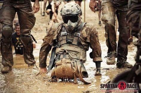 [image] USMC Cpl. Todd Love, a triple amputee, participates in the grueling 10.5 km Spartan Race. What's your excuse?