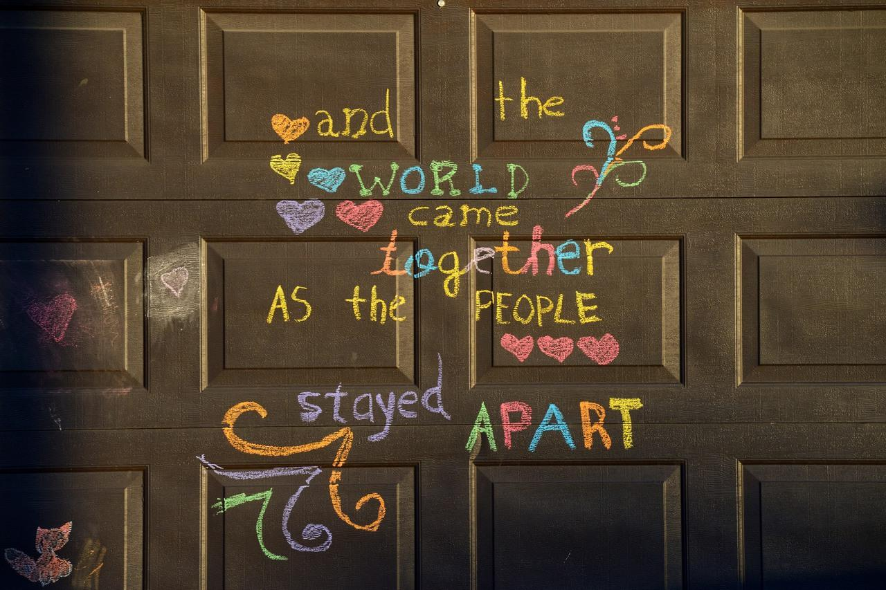 [Image] And the world came together as the people stayed apart, drawn on a garage door