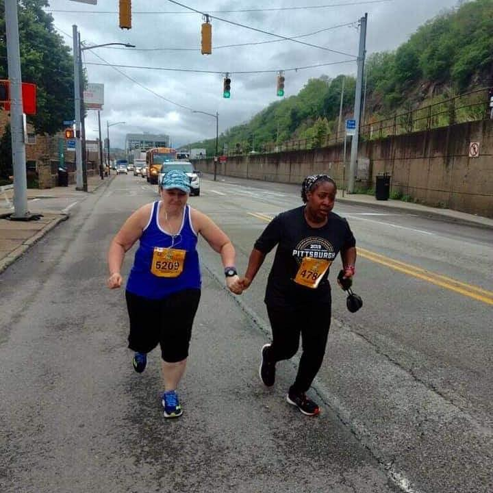 [IMAGE] The last two runners in the Pittsburgh Marathon not letting each other quit. Obtain your goal no matter what.