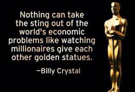 """Nothing can take the sting out of the world's economic problems like watching millionaires give each other golden statues. -Bii y Crystal 9 l"""". a.» A https://inspirational.ly"""